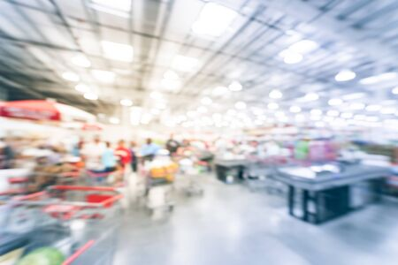 Blurry background busy checkout line at wholesale big-box store in America Stock Photo