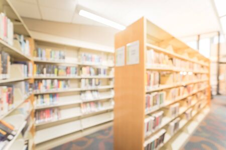 Blurry background wide view library bookshelf in American public library