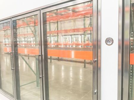 Large empty commercial fridges with temperature control at wholesale big-box store