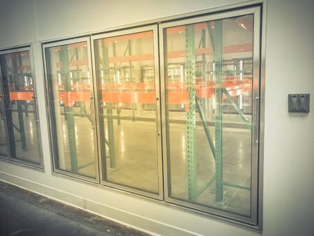 Empty commercial fridges with electrical outlet at wholesale big-box store