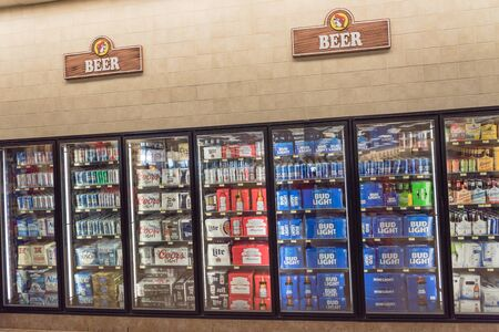 Bottles and cans of domestic and imported beer on display at American convenience store