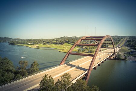 Filtered image Pennybacker Bridge over Colorado river and Hill Country landscape in Austin Reklamní fotografie