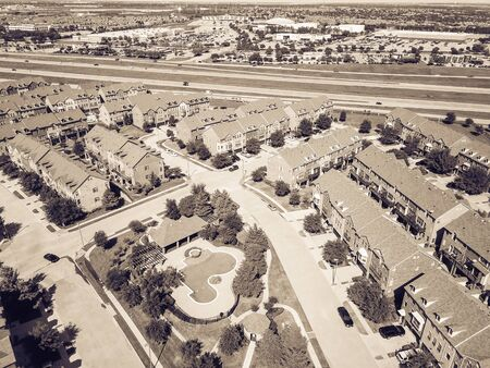 Filtered tone aerial view apartment building with swimming pool near highway and shopping streets