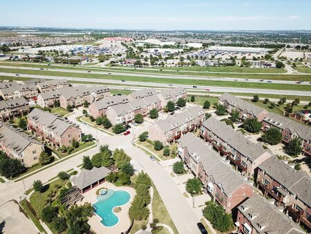Top view apartment building with pool near interstate 635 highway clear blue sky Stock Photo