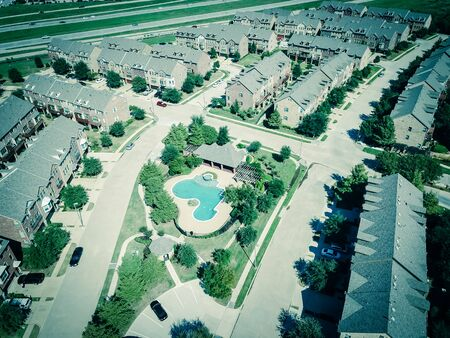 Top view new apartment building with pool near interstate 635 highway suburbs Dallas Stock Photo
