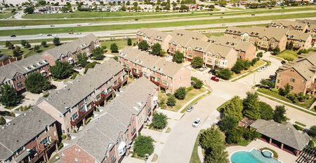 Panoramic aerial view apartment building with swimming pool near highway and shopping streets Stock Photo