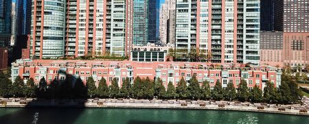 Panorama aerial view riverside skyscraper in downtown Chicago. Modern waterfront commercial and residential buildings, office spaces Stock Photo