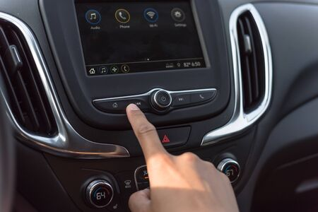 Close-up hand press the button to go Previous song, track or radio station on modern car