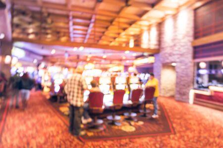 Blurry background players enjoy gambling at American casino Standard-Bild - 129318599