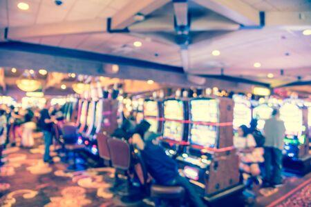 Blurry background players enjoy gambling at American casino Standard-Bild - 129318614