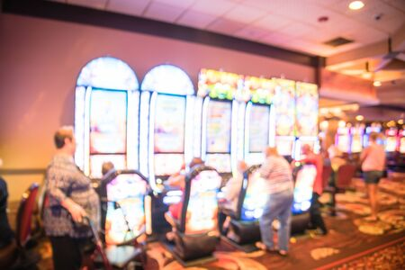 Blurry background typical casino in America with slot machines and themed game Standard-Bild - 129318618