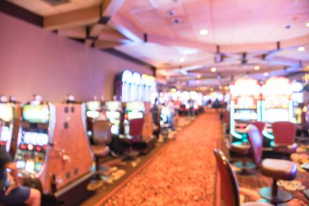 Blurry background typical casino in America with slot machines and themed game Standard-Bild - 129318623
