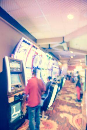 Blurry background players enjoy gambling at American casino Standard-Bild - 129318626