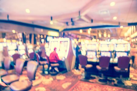 Filtered tone blurry background typical casino in America with slot machines and themed game