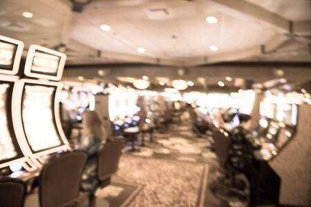 Filtered tone blurry background typical casino in America with slot machines and themed game Standard-Bild - 129318551