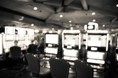 Filtered tone blurry background typical casino in America with slot machines and themed game Standard-Bild - 129318557
