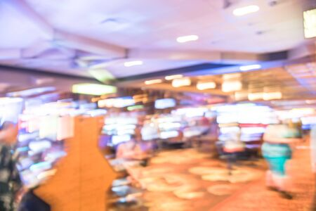 Blurry background typical casino in America with slot machines and themed game Standard-Bild - 129318559
