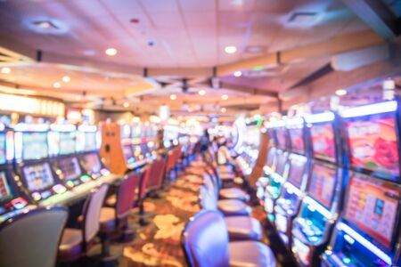 Blurry background typical casino in America with slot machines and themed game Standard-Bild - 129318563