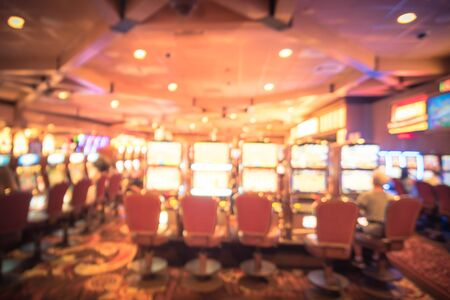 Blurry background typical casino in America with slot machines and themed game Standard-Bild - 129318567