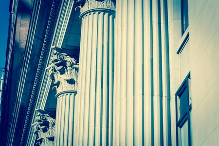 Lookup view union station pillars, government building columns in downtown Chicago, Illinois.
