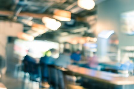 Vintage tone abstract blurred male customers sitting on bar counter at local local brewery in Kent, Washington. Defocused background modern lifestyle in American urban area. Standard-Bild - 129318449