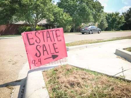 Red estate sale sign with 9AM to 4PM timeframe at suburban neighborhood near Dallas
