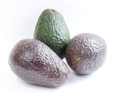 Mix of green and ripe avocados isolated on white background. Three whole organic Persea Americana, healthy fat fruits