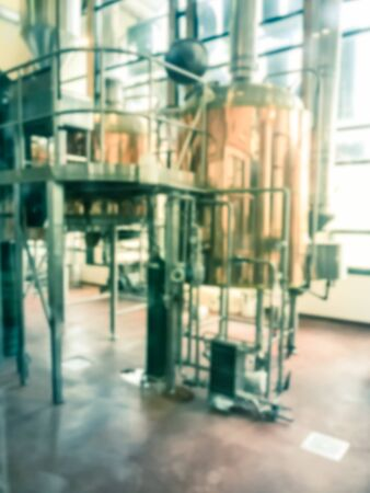 Vintage tone blurred image a full working brewery hops of local restaurant near Dallas, Texas. Row of shiny tanks fermented of standard beer styles and seasonal brews 写真素材