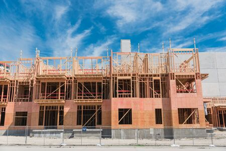 Construction site of new upscale condominium building near North Dallas, Texas, America under cloud blue sky. Wooden framework of luxury urban apartment complex with large patio near street Stock fotó - 132039161