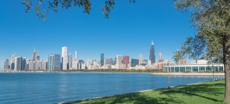 Panorama view lakefront Chicago skylines with trees from the park of Northerly Island along the shore of Lake Michigan