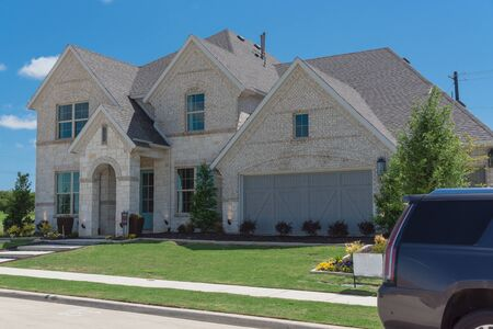 Two story house with attached garage in new development neighborhood near Dallas, Texas, USA. Stock Photo