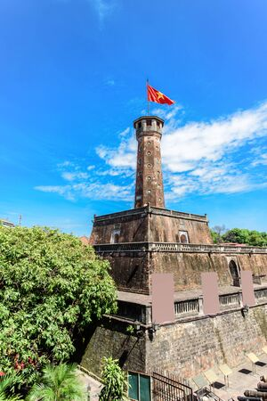 Flag tower with Vietnamese flag on top and empty standing posters. One of the symbols of the city and part of the Hanoi Citadel