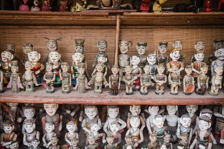 Common Vietnamese water puppets on display for sale as traditional souvenirs in Hanoi. Water puppet is a traditional art of Vietnam. Each represents a character in the life of ancient Vietnamese