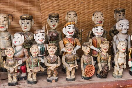 Colorful souvenir puppets used in the ancient art of water puppetry Roi Nuoc