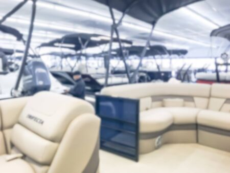 Motion blurred inside a large boat dealer selling variety of new and used boats near Dallas, Texas, USA. recreational boating buying, trade-in and servicing concept Imagens - 134209487