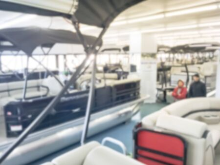 Motion blurred inside a large boat dealer selling variety of new and used boats near Dallas, Texas, USA. recreational boating buying, trade-in and servicing concept Imagens - 134209494