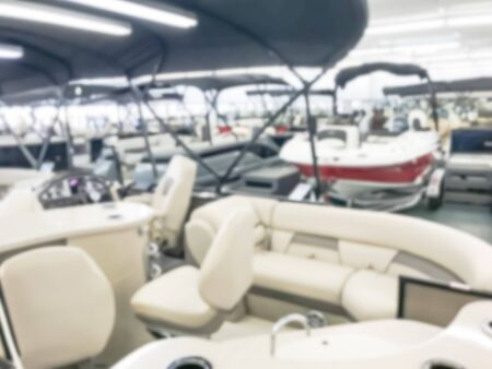 Motion blurred inside a large boat dealer selling variety of new and used boats near Dallas, Texas, USA. recreational boating buying, trade-in and servicing concept Imagens - 134209500