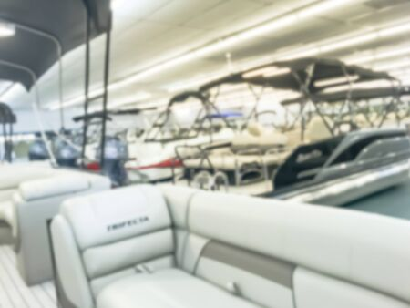 Motion blurred inside a large boat dealer selling variety of new and used boats near Dallas, Texas, USA. recreational boating buying, trade-in and servicing concept 版權商用圖片