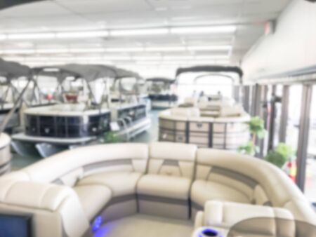 Motion blurred inside a large boat dealer selling variety of new and used boats near Dallas, Texas, USA. recreational boating buying, trade-in and servicing concept Imagens - 134209519