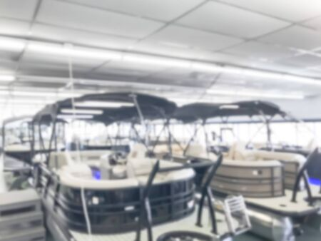 Motion blurred inside a large boat dealer selling variety of new and used boats near Dallas, Texas, USA. recreational boating buying, trade-in and servicing concept Stock fotó