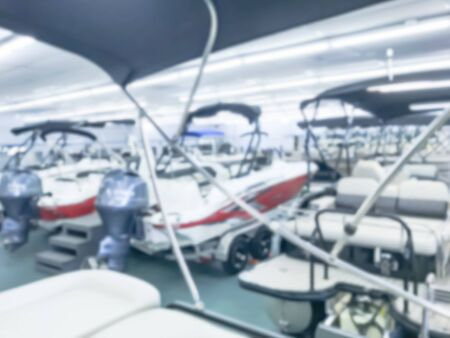 Motion blurred inside a large boat dealer selling variety of new and used boats near Dallas, Texas, USA. recreational boating buying, trade-in and servicing concept Imagens - 134209524