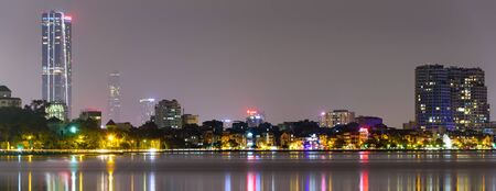 Panorama view Hanoi skylines reflection at West Lake Ho Tay . Hanoi is capital of Vietnam. Colorful cityscapes and urban concept