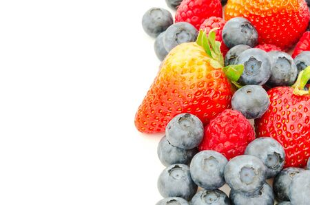 Arrangement of strawberries, blueberries and raspberries isolated on white background. Pile of variety organic and fresh pick berries with clipping path and copy space. Imagens - 134658506