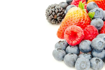 Assortment of blackberries, strawberries, blueberries and raspberries isolated on white background. Pile of variety organic and fresh pick berries with clipping path and copy space. Imagens - 134658899