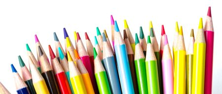 Top view pile of colored pencils isolated on white background. Bunch of assorted school supplies in rainbow arrangement. Back to school and creativity concept, clipping path and copy space Imagens - 134658922