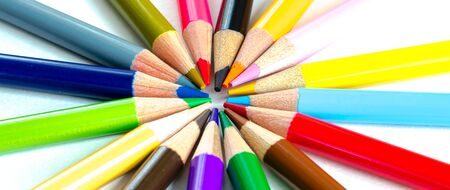 Panorama circle pattern of colored pencils isolated on white background. Bunch of assorted school supplies in rainbow arrangement. Back to school and creativity concept, education background
