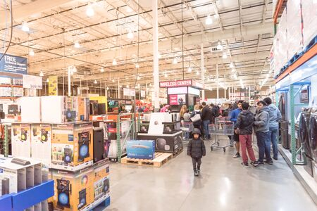LEWISVILLE, TEXAS, USA-NOV 29, 2019: Electronics department and wireless center at Costco with busy customer browsing and buying special deal on Black Friday shopping vent. Editorial