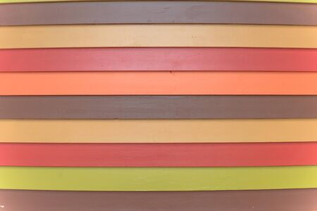 Rainbow color vinyl wooden siding panel background with imitation wood texture. House wood wall slice or planking vintage texture for horizontal background