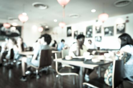 Toned photo blurred abstract background of a Chinese cafe restaurant with red lantern decoration. Diverse customers enjoying meal and beverage in warm light. Zdjęcie Seryjne - 137998456