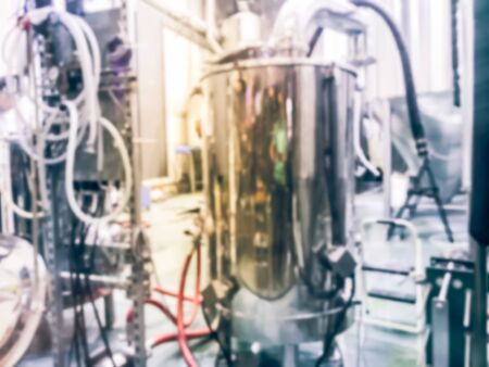 Abstract blurred beer brewing tanks at local brewery company in North Dallas, Texas, America. Shiny stainless steel beverage storage container equipments Imagens